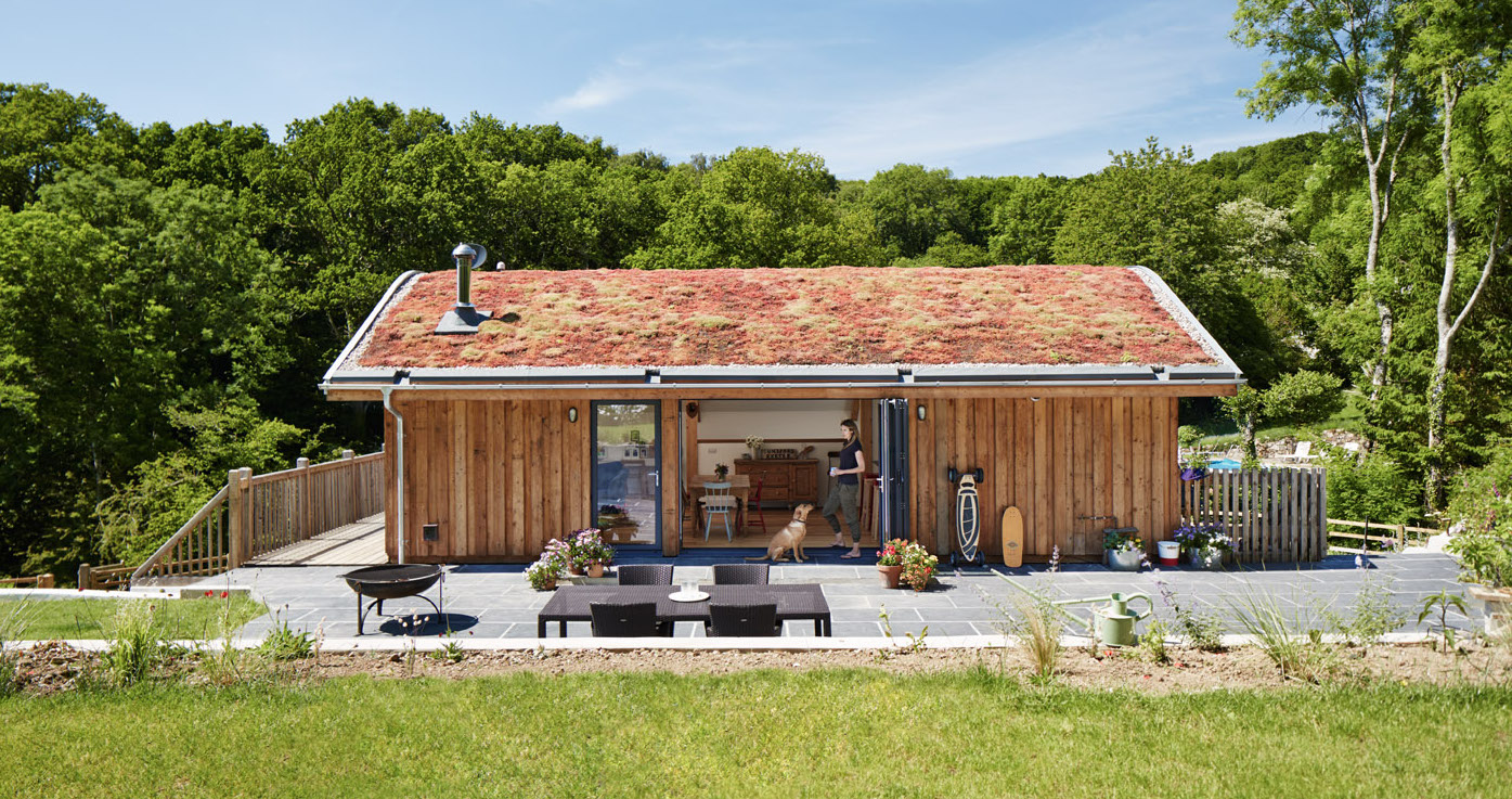 New Sustainable family home with a curved grass roof